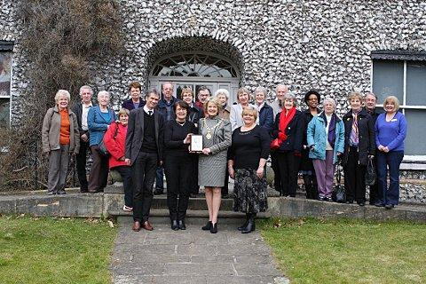 WDC chairman Cllr Wendy Mallen presents the award to Wycombe Museum staff and volunteers