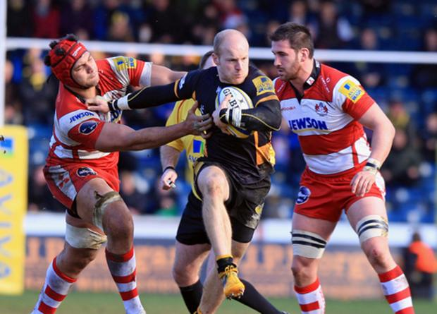 Joe Simpson takes on the Gloucester defence