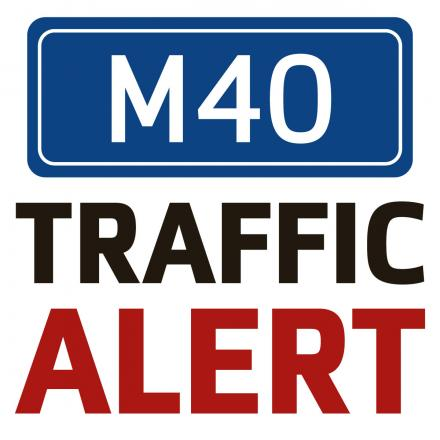 Delays as lorry overturns on M40
