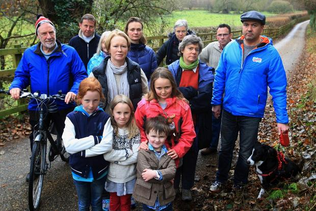 Residents oppose the project along the country lane