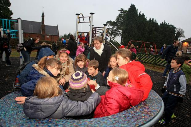 Delighted faces at new play equipment