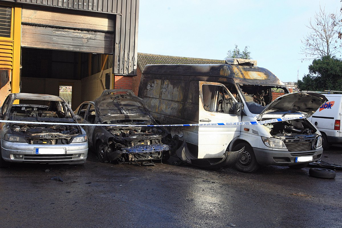 Updated: Arson suspected as building damaged in five vehicle fire
