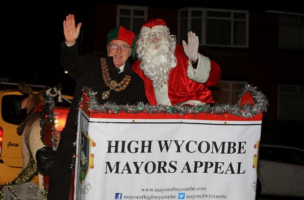 Santa and Mayor hand out presents and collect charity money