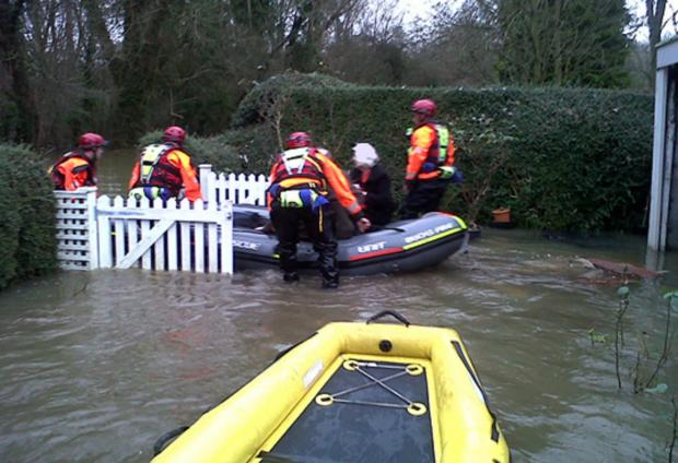 Residents rescued from home after being cut off by floods