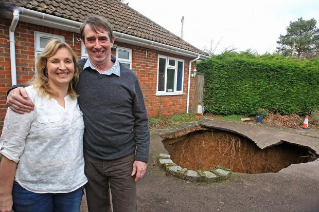 Bucks Free Press: Phil and Liz Conran outside their home in Walter's Ash