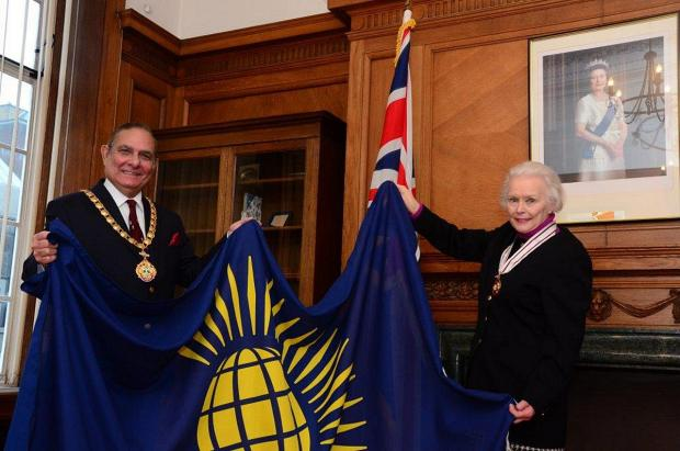 The flag is presented to Cllr Ian McEnnis, Chairman of Wycombe District Council, by The Countess of Buckinghamshire