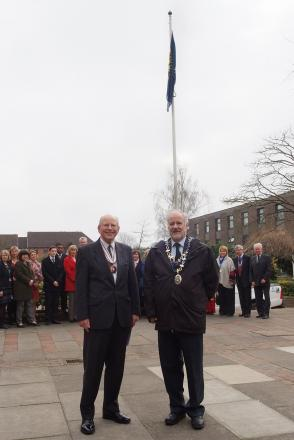 Deputy Lieutenant of Buckinghamshire Roger Connor and CDC chairman Noel Brown with the flag