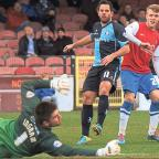 Bucks Free Press: York City winger Will Hayhurst watches as a shot is kept out by Wycombe keeper Matt Ingram