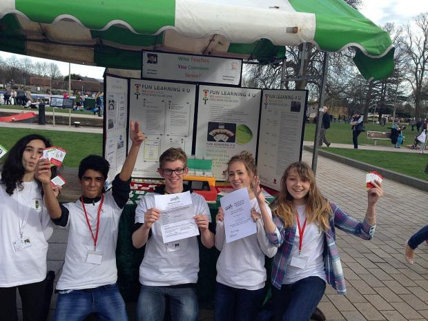 Salima-Lina Zaher, Asim Asghar, Jacob Burridge, Eleanor Jones and Charlotte Rumsey, in front of their stall with the certificates.