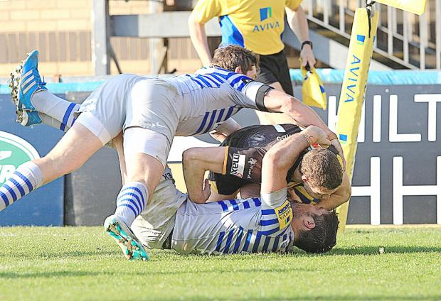 Jonah Holmes is held up trying to score a second try against Saracens