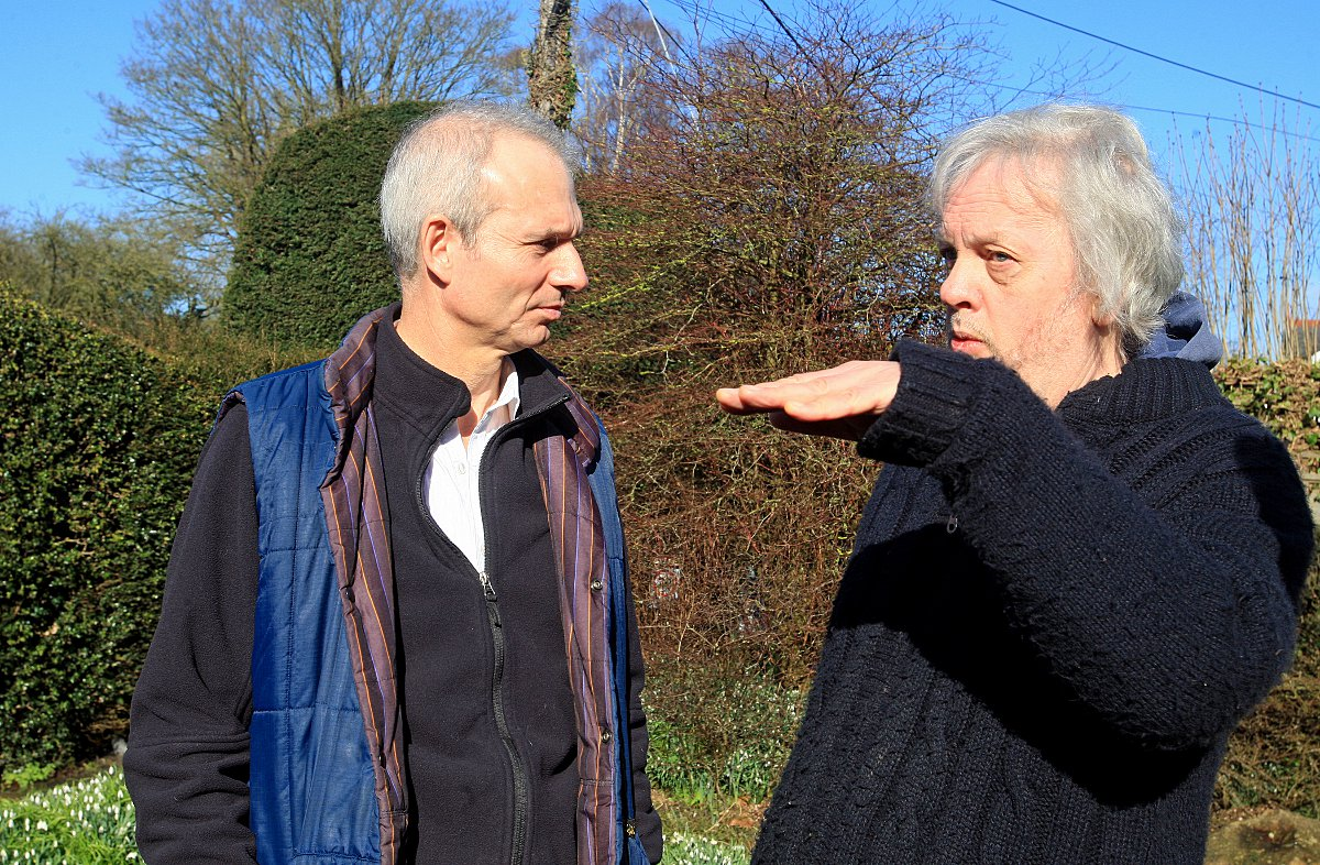 David Lidington on the left talking to one of the Hughenden Valley residents