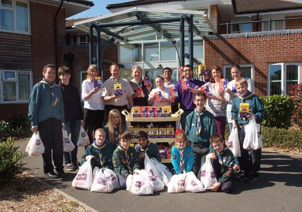 Scouts hand out Easter eggs to care home residents