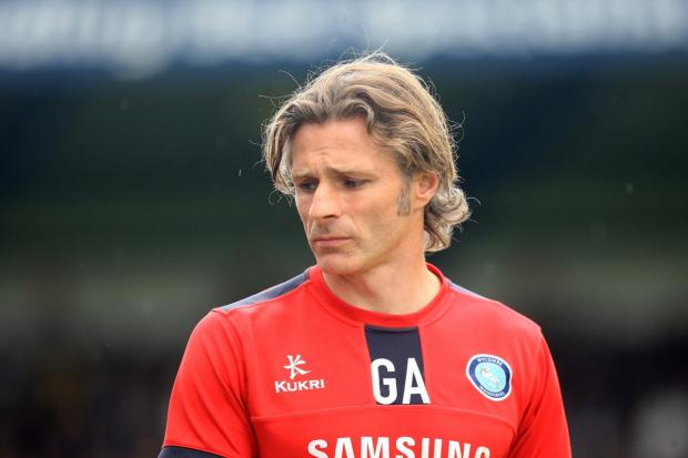 Bucks Free Press: Gareth Ainsworth cuts a disconsolate figure as time runs out on Wycombe Wanderers' stay in the Football League