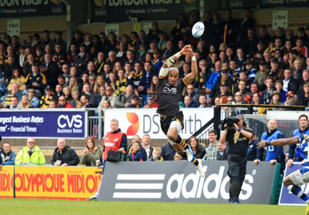 Tom Varndell just fails to take Andy Goode's cross chip.