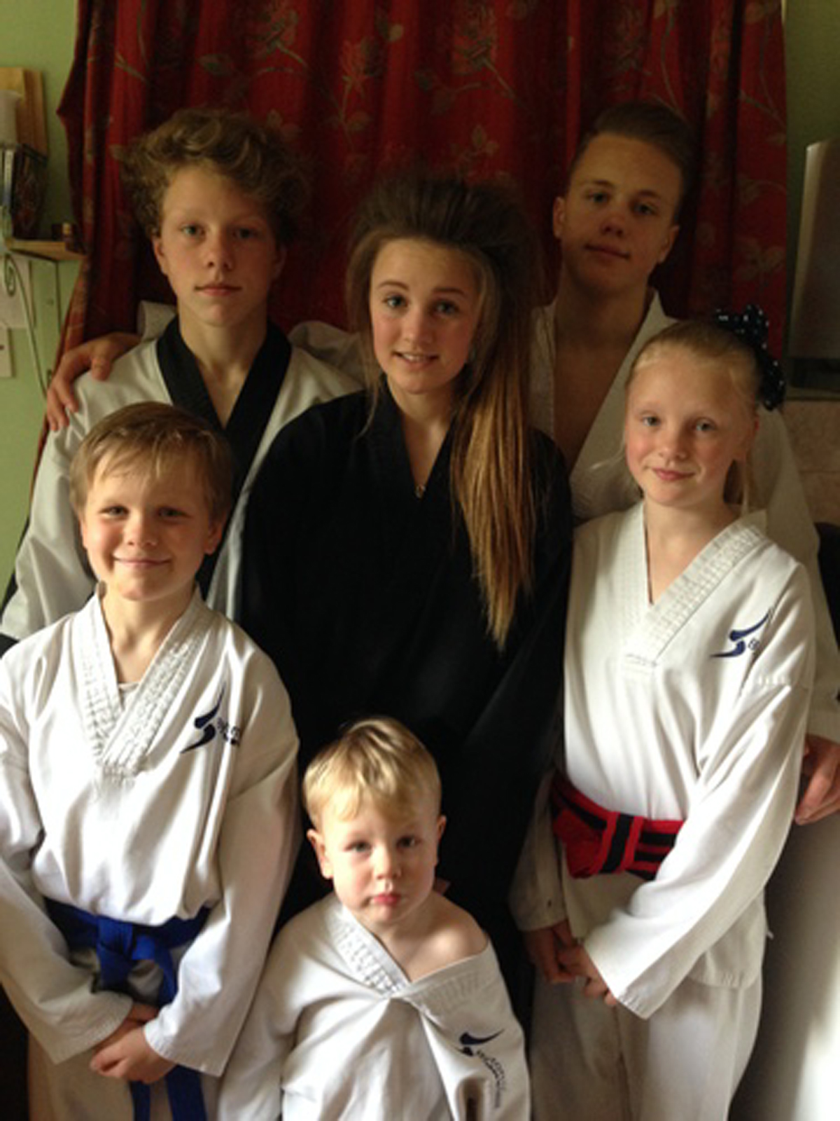 Black belts Florence, Adam, India and Charlie with siblings Billy and Harvey.