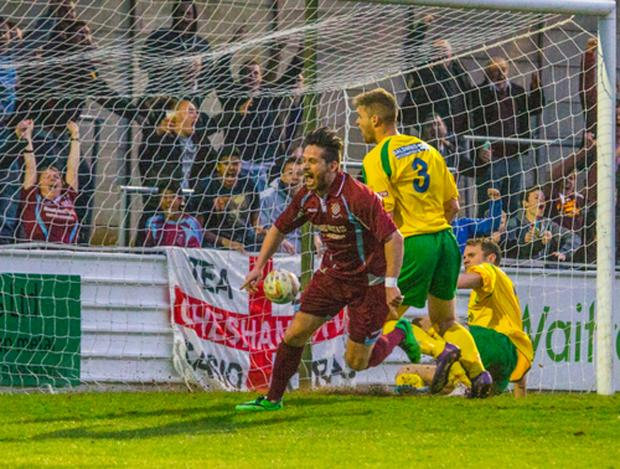 Drew Roberts celebrates one of his many goals for Chesham last season. Photo by Trevor Hyde