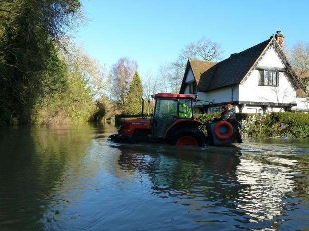 The 'tractor taxi' which became a lifeline for villagers in Medmenham during the floods