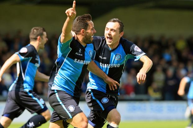 Bucks Free Press: Sam Wood celebrates scoring the opening goal as Wanderers pulled off the great escape at Torquay