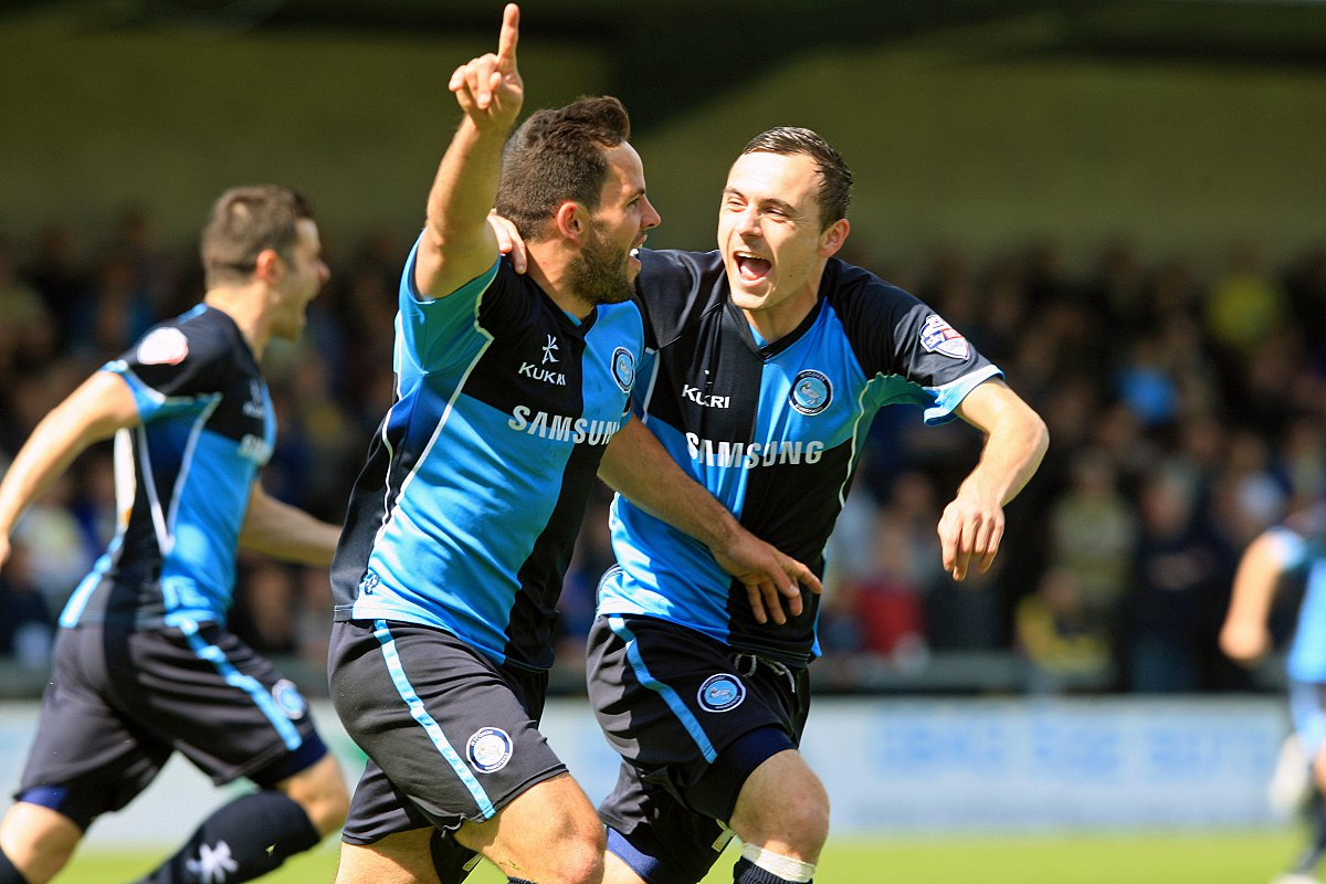 Sam Wood celebrates scoring the opening goal as Wanderers pulled off the great escape at Torquay