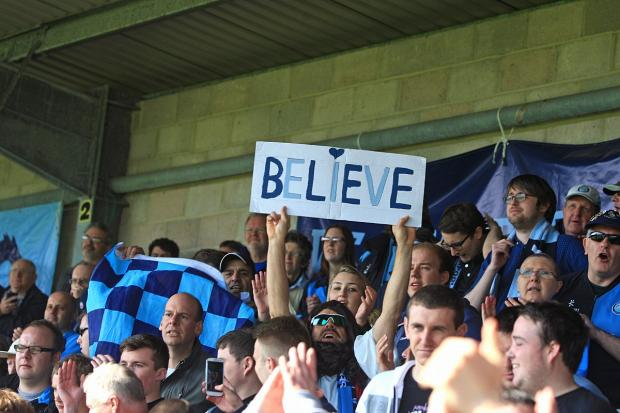 Bucks Free Press: 'Believe' was the message from Wanderers fans before their final day showdown at Torquay that preserved Football League status
