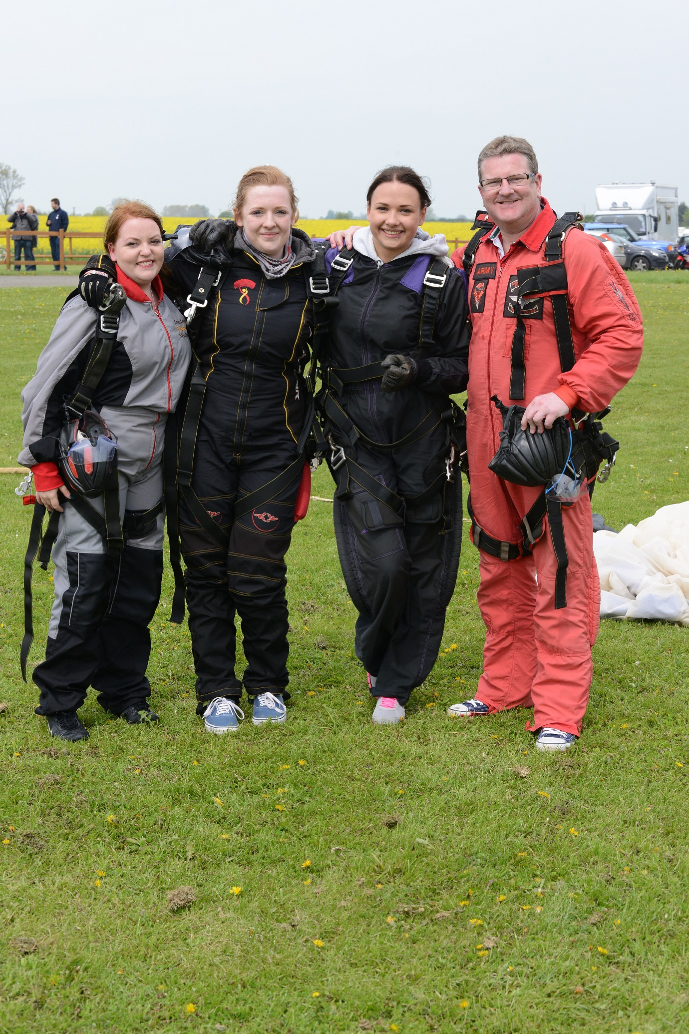 Mark Shaw after completing his skydive, with (l-r) Natalie Else, Beth Shaw and Ernesta Petkeviciute