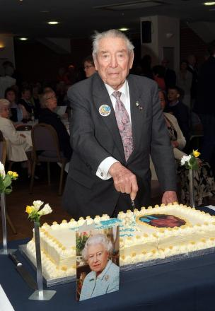 Monty Seymour cuts the cake at his 100th birthday party