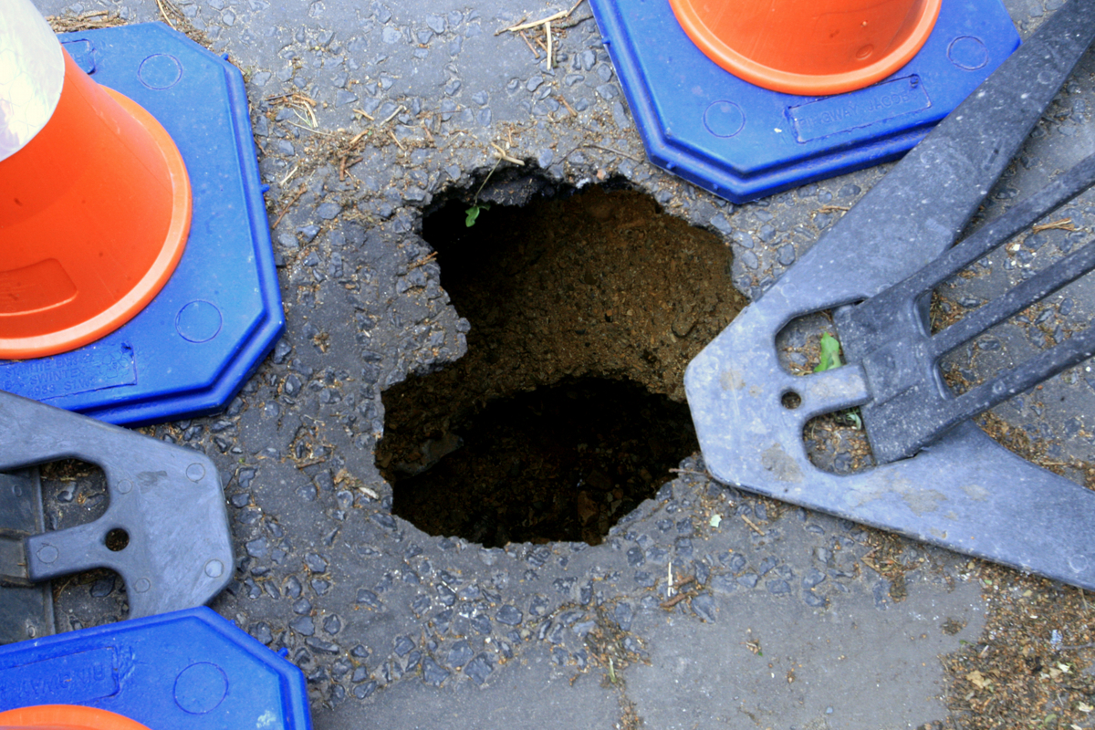 Sinkhole opens up on main road
