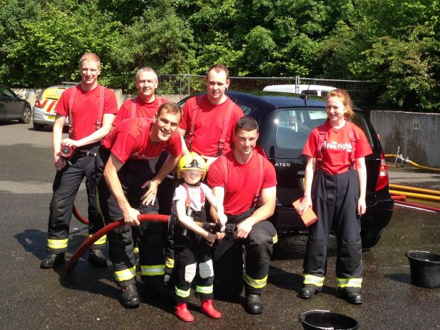 Fire crew hose down cars for charity