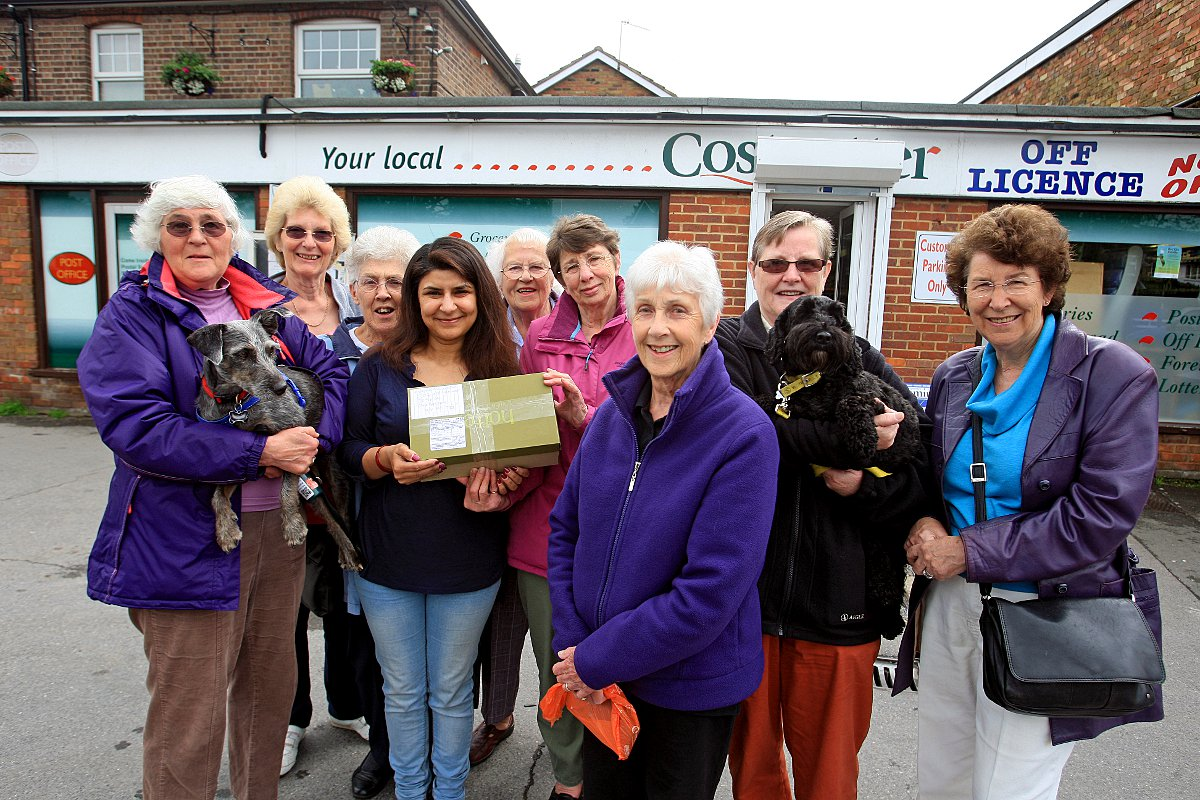 Prestwood WI members hand over the 2,500th shoebox to postmistress Rimple Mehta