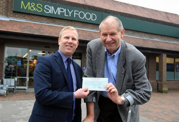 Store manager, Jason Manders, gave the money to the centre's chairman, Carl Etholen