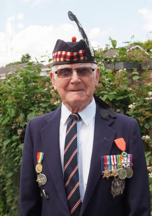 D-Day veteran Peter Graham with his medals