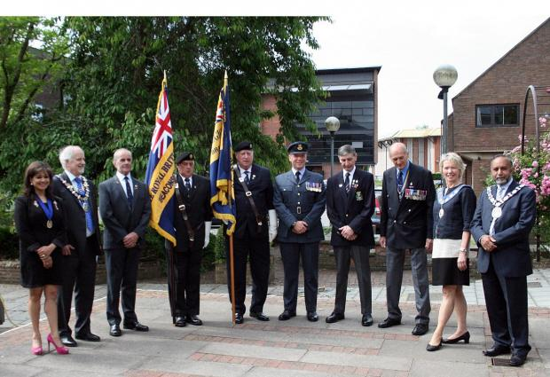 Dignitaries at yesterday's flag raising ceremony