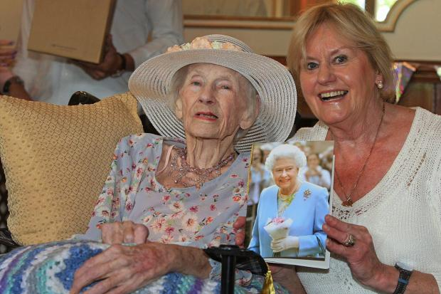 Elizabeth McManus and daughter Sally Wicks with her card from the Queen