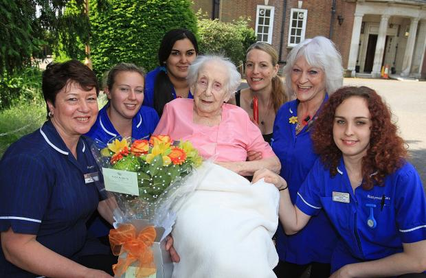 Joy Bovingdon with staff at the Rushymead Care Home in Coleshill