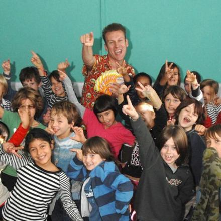 Paul Lyalls with youngsters at one of his poetry classes