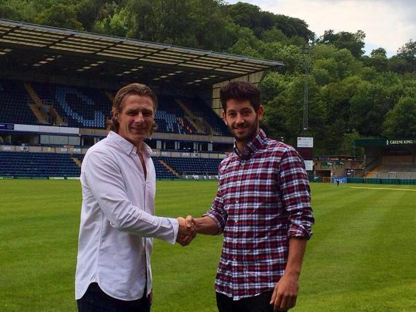 Joe Jacobson shakes hands with his new manager, Gareth Ainsworth