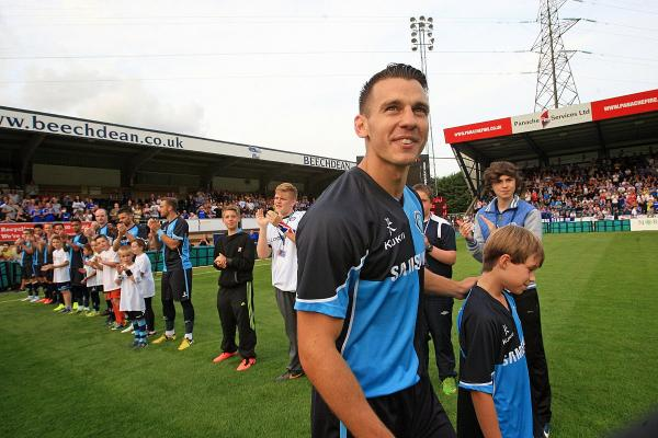 Matt Bloomfield laps up the applause after being given a guard of honour by Wanderers and Chelsea players