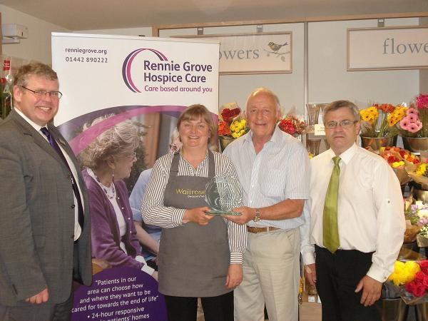 Shop presented with plaque after fundraising efforts