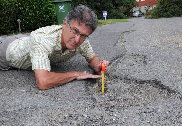 B&B owner takes a stand over potholes