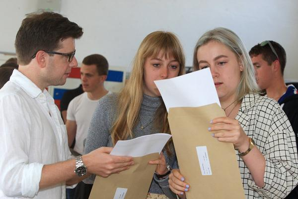 A Level twins score big with almost identical grades