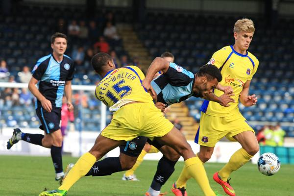 Aaron Holloway leads a determined charge at the Carlisle defence