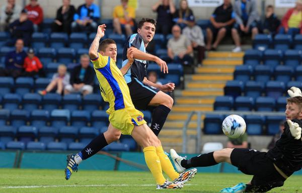 Peter Murphy scores the clinching third goal against Carlisle on Saturday