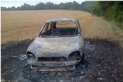 Stolen car found burnt out in field