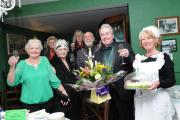 Margaret (front row, second left) and Danny Clifford (front row, second right), waitress Jane Baker (right), Deputy Mayor Wally Woolf, wife Doreen and friends toast the new tea shop.