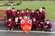 Young schoolchildren embrace the Chinese New Year
