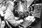 A worker using a Linotype machine in 1937