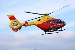 Man airlifted to hospital after being trapped under car