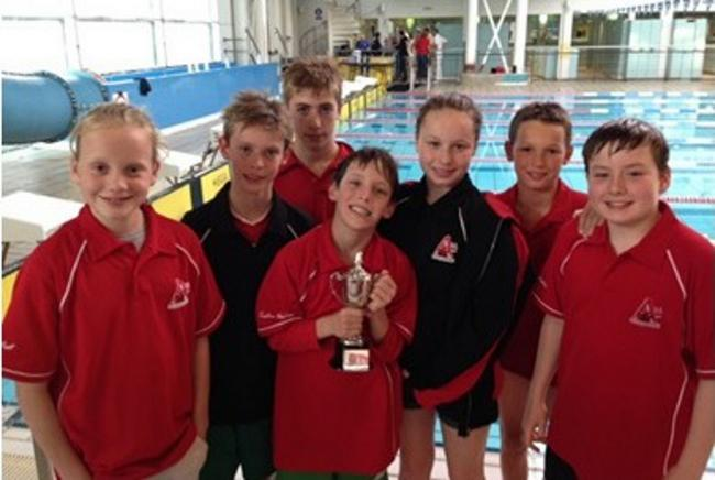 Lucy West, Dylan Woolven, Liam Ballard, Tristan Woolven, Amber Restall, Joey Bennetts and Nicholas Michau show off the trophy for Top Visiting Club.