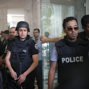 Bucks Free Press: Tunisian police officers at a hotel in Sousse where a terrorist attack took place (AP)