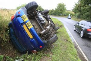 Two cars overturn on notorious lane after heavy rain batters south Bucks
